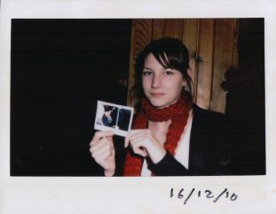 Jenny holding a picture of herself